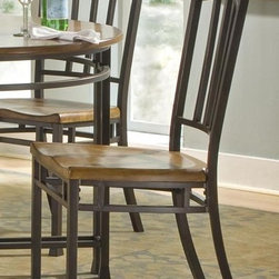 HomeStyles - Oak Hill Dining Chair in Distressed Oak Finis - Set of 2. Traditional style. Stylish metal back and legs. Accented rubbed edges. Uniquely hand distressed contoured seat. Nylon levelers to ensure stability. Made from ash solids and oak veneers. Antiqued bronze frame color. Seat height: 18 in.. Overall: 18 in. W x 18 in. D x 40 in. H. Assembly InstructionsThe Oak Hill chairs are reminiscent of traditional mission styling.