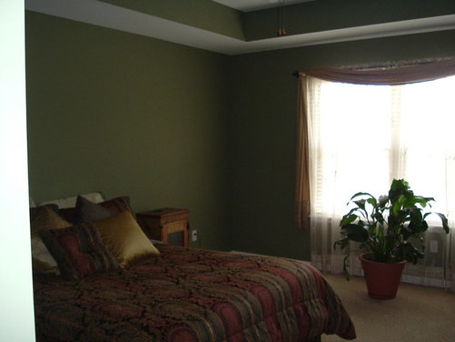 I have a really dark green bedroom and cherry furniture for Dark green bedroom ideas