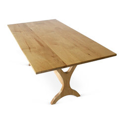 Springhouse Shop and Studio, Inc - Atlas Trestle Table - Unique lines and beautiful natural Maple grain are the highlights of this hardwood trestle table. Suitable for use as a dining table for four to eight people. This entirely solid wood piece was designed and handcrafted in Pennsylvania.