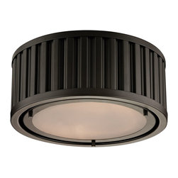 Elk Lighting - EL-46130/2 Linden 2-Light Flush Mount in Oil Rubbed Bronze - The Linden Collection features a drum shape made from a textural wall of metal or crystal. A frosted glass diffuser (metal tube items) or textured clear glass (crystal items) is cleverly recessed into the drum for a smooth, seamless appearance. Various finishes, including polished nickel, brushed nickel, aged brass and oil rubbed bronze are adaptable into any color scheme.