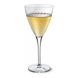Luigi Bormioli - Luigi Bormioli Hypnos 12.75 oz. White Wine Glasses - Set of 4 - 10945/01 - Shop for Drinkware from Hayneedle.com! Elegant high-tech blown glass and a large bowl with an innovative spiral optic design highlight these Luigi Bormioli Hypnos 12.75 oz. White Wine Glasses - Set of 4 a perfect addition or upscale replacement to your bar and glassware collection. The spiral optic design allows for maximum aeration and breathability for your favorite white vintage and producing peak aromas and flavors after the pour. The glasses feature titanium reinforced stems and are 100 percent free and dishwasher safe. Also dishwasher or top-rack dishwasher safe the set was produced in Italy.About Luigi BormioliFounded in 1946 by Mr. Luigi Bormioli himself the Bormioli family continues Luigi s mission of commitment to great design traditional Italian craftsmanship and new innovative glassmaking technology to produce the world s most beautiful and durable glassware. Producers of wine glasses tumblers decanters and everything in between Luigi Bormioli is located in Parma Italy halfway between Bologna and Milan and is influenced by the region s reputation for art music and higher learning. Bormioli s glassmaking construction rivals fine crystal in its appearance but is 100-percent lead-free affordable and widely available.