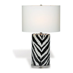 "Kathy Kuo Home - Kenya Modern Black and White Zebra Print Tea Jar Table Lamp- 28""H - When it comes to exotic chic, there's nothing like a monochrome animal print lamp to add a little extra interest.  This porcelain zebra stripe lamp creates the perfect compliment to a contemporary exotic or even Hollywood Regency inspired space."