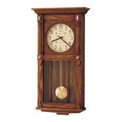 HOWARD MILLER - Howard Miller Ashbee II Dual Chime Wall Clock - The cream dial features dark brown numerals and hands. Decorative, wooden moldings frame the dial.