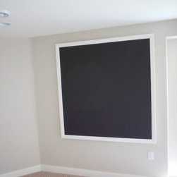 basement living area - We had two electrical panels that we wanted to hind, and the client wanted a chalkboard for their kids, so we made a chalkboard that opens up.