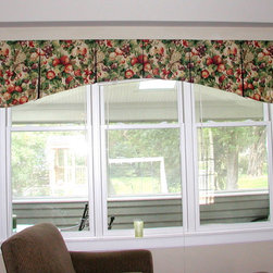 "Window Treatments - Top Treatments - 2"" wood blinds with a custom hand-sewn board mounted box pleated valance, arched lower edge contrasting fabric in pleats, lined and interlined."
