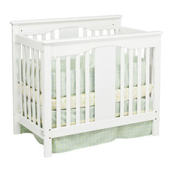 """DaVinci - Annabelle Mini 2-in-1 Convertible Crib - The Annabelle Mini 2-in-1 Convertible Crib is designed to meet the budget of the American family. Ideal for staying at the grandparents, this crib is the perfect solution to conserve space. The Conversion Bed Rails are a very simple and cost effective solution to transition your child's crib to a twin size bed. Crib Features: -Annabelle collection. -Four adjustable heights. -Meets and exceeds all US safety standards. -1"""" Mattress pad included. -Converts to twin-sized bed with Optional Bed Rails. -Linens not included. -Mattress not included. -Constructed from New Zealand Radiata Pine Wood. -This is a NON-Drop Side crib. Dimensions: -43.5"""" H x 38"""" W x 25.25"""" D. ***Please note that these products cannot be shipped to Alaska, Hawaii or Puerto Rico. We apologize for the inconvenience - feel free to call us regarding alternatives! This Crib is approved for use in the United States."""