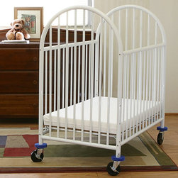 LA Baby - LA Baby Compact Metal Non Folding Crib with 3 in. Mattress - CS990 - Shop for Cribs from Hayneedle.com! With a metal frame and a classic shape the LA Baby Compact Metal Non Folding Crib with 3 in. Mattress is a mixture two great things like chocolate in your peanut butter without all the sticky mess and unnecessary calories. Featuring a high arched head and foot this sturdy metal crib features three adjustable mattress heights for the 3-inch thick vinyl-covered mattress. The body is powder-coated with an easy-to-clean non-toxic finish in case you DO actually have a sticky mess and rolls on heavy-duty rubber casters with foam bumpers to protect furniture and doorways. Two of the casters can be locked for stability and the mattress meets all Federal Flammability Standards.About LA BabyL.A. Baby is an award-winning division of Amwan a manufacturer and distributor of fine quality juvenile furniture. With products designed for residential and commercial use L.A. Baby items can be found in homes day cares and hotels. Based in City of Industry California L.A. Baby offers a wide range of baby items including cribs strollers safety gates changing pads and high chairs.
