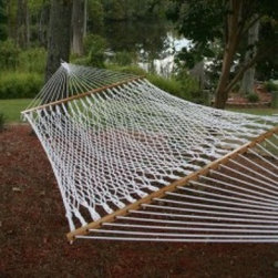 Pawley's Island Original Collection Cotton Rope Hammock - Watch the clouds roll by and dream of the future with that special someone. Three-ply twisted rope reinforces bed strength while cotton rope fibers breathe for cool, comfortable lounging. Spreader bars are constructed of solid oak for premium durability and strength. Spreader bars are triple dipped in marine spar varnish to lengthen life. Spreader design enhances gentle swaying motion. 3/16 proof coil affixes to two inch diameter ring for hanging versatility.