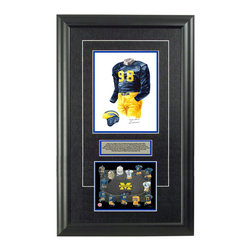 """Heritage Sports Art - Original art of the NCAA 1940 Michigan Wolverines uniform - This beautifully framed NCAA football piece features an original piece of watercolor artwork glass-framed in an attractive two inch wide black resin frame with a double mat. The outer dimensions of the framed piece are approximately 17"""" wide x 28"""" high, although the exact size will vary according to the size of the original piece of art. At the core of the framed piece is the actual piece of original artwork as painted by the artist on textured 100% rag, water-marked watercolor paper. In many cases the original artwork has handwritten notes in pencil from the artist. Simply put, this is beautiful, one-of-a-kind artwork. The outer mat is a rich textured black acid-free mat with a decorative inset white v-groove, while the inner mat is a complimentary colored acid-free mat reflecting one of the team's primary colors. The image of this framed piece shows the mat color that we use (Medium Blue). Beneath the artwork is a silver plate with black text describing the original artwork. The text for this piece will read: This is an original, one-of-a-kind watercolor painting of the 1940 Michigan Wolverines uniform worn by 1940 Heisman Trophy winner #98 Tom Harmon and was used in the creation of this Michigan Wolverines uniform evolution print and thousands of Michigan products that have been sold across North America. This original piece of art was painted by artist Nola McConnan for Maple Leaf Productions Ltd. Beneath the silver plate is a 6.5"""" x 7"""" reproduction of a uniform evolution print that celebrates the history of the team. The print beautifully illustrates the chronological evolution of the team's uniform and shows you how the original art was used in the creation of this print. If you look closely, you will see that the print features the actual artwork being offered for sale. The 6.5"""" x 7"""" print is shown above. The piece is framed with an extremely high quality framing glass. We have """