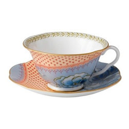 Wedgwood Butterfly Bloom Teacup and Saucer Set - Blue Peony - Elegant enough to serve tea to the queen, the Wedgwood Butterfly Bloom Teacup and Saucer Set - Blue Peony features soft colors and a delicate floral motif. Dishwasher safe, this gorgeous cup and saucer is crafted from fine bone china and finished with a lustrous gold trim which brings out the details of the vintage-inspired floral motif. About WedgwoodThrough highly skilled craftsmanship and the highest quality standards, Wedgwood manufactures quality ceramics with sophisticated, classical, and contemporary design. With a tradition of innovation, quality, and craftsmanship, Wedgwood designs are widely acknowledged as timeless, elegant, classic, and understated. Their design teams work with external designers for cross-pollination of ideas and experience. Founded in 1759 by Josiah Wedgwood, Wedgwood has been an international company determined to uphold their standards in order to maintain their leadership in the world's markets. Though their roots are over two centuries old, the company strives to stay current through partnerships with fashion designers Jasper Conran and Vera Wang with whom they've developed contemporary and stylish ranges that appeal to the younger consumers.