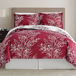 None - Red and White Leaf 8-piece Bed in a Bag with Sheet Set - This bedding set features a beautiful red tree pattern on white comforter with the negative image on the reverse side. Matching sheets and pillowcases feature a stenciled pattern of leaves, softening the bold tones of the comforter and shams.