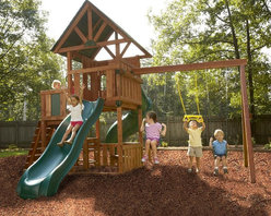 Swing-N-Slide - Swing-N-Slide Southampton Wood Swing Set Multicolor - PB 8202 - Shop for Swings Slides and Gyms from Hayneedle.com! The Southampton Wood Complete Play Set will have you saying couch potato who? Designed to keep the kids outside when the weather is nice and even when it's borderline. Complete with tons of safety features like an award-winning bracket system and safety handles this play set also features tons of activities from slides to climbing walls from picnic tables to sandboxes. So say goodbye to the Wii and hello to the wee.Additional information:3 play decks create a total of 29 square feet of play areaAll premium stained pre-cut lumberAward winning Rapid-Loc Bracket SystemSoaring decorative gabled wood roof3 paned windows with decorative shutters4-foot roped climbing wall with 8 climbing rocks1 tunnel twister slide and 1 wave slidePicnic table magnetic chalkboard 2 swing seats ring/trapeze comboSafety handles and Anchor-it KitComplete with manufacturer's 5-year limited warrantyAbout Swing-N-SlideFounded in 1985 Swing-N-Slide was America's first manufacturer of do-it-yourself wooden playground products. This remarkable company designs manufactures and distributes residential and commercial play sets across the nation. Committed to safety and driven by a desire to provide compliant fun and value-packed products Swing-N-Slide backs every play set with quality and pride. They offer unparalleled value and the unique opportunity to tailor playground products to your specific needs and budget.