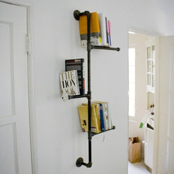 Industrial Pipe Bookshelf with Antique Knob by Dirty Bils - I think reading a good book is the best way to spend a winter afternoon, and this is one of the best book displays I have seen.