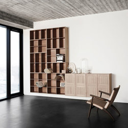 Carl Hansen & Son - Carl Hansen & Son Koch Bookcase - A bookcase that can be as big as the imagination,  the Koch Bookcase sytem reaches the extremes of both a small simplistic bookshelf to a customized bookcase that stretches across a wall.  The bookcases in the system can be combined with one another to create endless combinations and sizes.  Elements includes open shelves, thin shelves, and shelves with doors.  The bookshelf is made with solid wood and comes in a variety of finishes.  Elements can be purchased individually or be combined to create unique arrangements.  Bookcase can hang on the wall or sit on the floor.  Price includes shipping to the USA.  Manufactured by Carl Hansen & Son.Designed in 1928.
