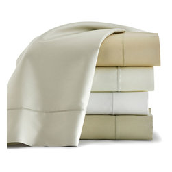 Soprano Pillowcase Pair - Made from glamorous Egyptian cotton with a sleek sateen finish, the Soprano Pillowcases are a sumptuous neutral choice for making a bed feel like a sanctuary.  Choose luxurious familiarity when you select these exquisitely smooth 420-thread-count pillowcases, classically trimmed in a simple blanket stitch, as the foundation for an elegant collection of bedding.