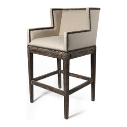 French Country Contemporary Nail head Linen High Backed Bar Stool - Luxurious, comfortable seating and bar stools needn't be mutually exclusive, and this stylish nail head stool proves it once and for all. With a cushioned, wingchair-inspired linen seat back, armrests and ample seat space, you'll never want to push away from the bar in your rustic or French country style home to adjourn for dinner.