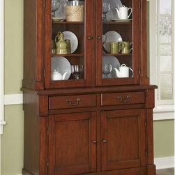 Home Styles - Home Styles Aspen China Cabinet Multicolor - 5520-617 - Shop for Buffets and Side Boards from Hayneedle.com! The treasured teapot your grandmother gave you and the table linens you use every Thanksgiving will have a beautiful home inside the Home Styles Aspen China Cabinet. Ideal for displaying protecting and organizing your favorite pieces and frequently used dining essentials this elegant china cabinet consists of a bottom buffet and a top hutch for abundant storage. The buffet contains two drawers to hold silverware serving utensils and other items. The two-door cabinet opens to two adjustable shelves for bowls plates table linens and more. You can display your favorite dishes teacups pitchers and other items in the hutch which contains four shelves behind two glass doors. Made from mahogany solids engineered wood and cherry veneers this china cabinet features a rustic cherry finish. Picture frame moldings rich carved detail and antiqued brass-finished hardware complement the sophisticated traditional style. About Home StylesHome Styles is a manufacturer and distributor of RTA (ready to assemble) furniture perfectly suited to today's lifestyles. Blending attractive design with modern functionality their furniture collections span many styles from timeless traditional to cutting-edge contemporary. The great difference between Home Styles and many other RTA furniture manufacturers is that Home Styles pieces feature hardwood construction and quality hardware that stand up to years of use. When shopping for convenient durable items for the home look to Home Styles. You'll appreciate the value.