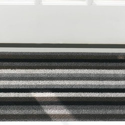 Chilewich - Even Stripe Shag Door Mat by Chilewich - The Chilewich Even Stripe Shag Door Mat creates visual interest with a pattern of evenly spaced stripes. These stripes come in contrasting colors, available in the platinum-to-carbon palette called Mineral. Made out of tufted vinyl, this mat adds a durable and sophisticated accent to both indoor and outdoor spaces. For over a decade, New York based designer Sandy Chilewich has been creating original and innovative vinyl products for the home. Her woven, tufted, molded and spun textiles are available in a range of vibrant and neutral hues that have become synonymous with the Chilewich brand name.