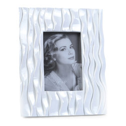 "Concepts Life - Concepts Life Photo Frame  Flowing Forward 4x6"" - Make your photos stand out with our white textured frame from the Flowing Forward collection. The beautifully woven pattern on this white frame is both elegant and eye-catching. Makes a memorable gift for any occasion.  Modern home accent Contemporary white picture frame Beautiful and elegant home accent Rectangular photo frame Made of polyresin Textured finish Easel back for horizontal or vertical display Various sizes available Holds 4 x 6 in. size photo Dimensions: 8""w x 10""h x 1""d Weight: 2 lbs"