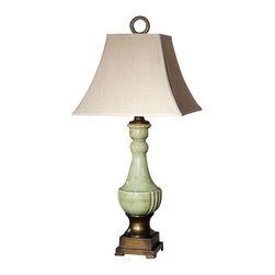 Uttermost Ceralto Green Glaze Table Lamp - Crackled ceramic finished in an antiqued mossy green glaze with golden bronze metal details. Crackled ceramic finished in an antiqued mossy green glaze with golden bronze metal details. The square bell shade is an ivory linen fabric with natural slubbing.