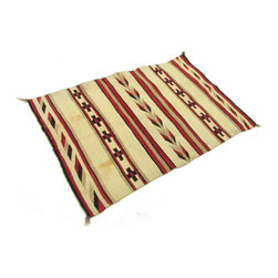 """Consigned Antique Navajo Rug with Crosses and Feathers 4'3"""" x 2'10"""" - A lovely 1930s Navajo rug with stripes, feathers, and crosses in cream, red, black, and tan. A versatile piece, it can be used by your fireplace, bedside, or in the hallway. There are some stains and damage, although this sturdy handmade piece will stand the test of time on your floor for many generations to come."""
