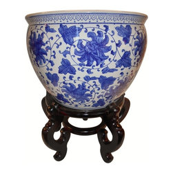 "Oriental Furnishings - Blue and White Porcelain Jardiniere For Indoor Or Outdoor Use, 18"" - Our unique Chinese 18"" Planters is also available in 10"",14"" and 16 ""Diameter's. These porcelain planters are beautifully patterned with blue Asian floral line drawing that makes an outstanding statement in any room. These Oriental fishbowls are the perfect accent for home or garden. Water tight and hand painted with floral and arabesque in rich blue cobalt glaze. We suggest them for outdoor use and our Oriental vase stand for added elegance and display when used indoors. Use in a grouping with other blue and white porcelains on a table top for an eye catching grouping. Use as a planter on the ground or on a table top."