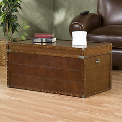 Steamer Trunk/ Cocktail Table - The classic steamer trunk would work well for a coffee table. Love the storage and the large space for doing some styling on top of it.