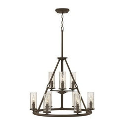 Hinkley Lighting - Hinkley Dakota Oil Rubbed Bronze Nine-Light 29 Wide Chandelier - The Dakota collection rounds up the best in Western style with a rustic chic design. Cast metal faux leather straps and buckle combine with clear seedy hurricane shades perched on cast cups for luxe lodge charm.Under four generations of family leadership Hinkley Lighting has transformed from a small outdoor lantern company to a global brand intent on bringing you the best in style quality and value. LIFE AGLOW: That's their mantra and they take it seriously. By welcoming their products into your home they become part of your family's everyday life illuminating small moments and big occasions. They understand your home is so much more than a physical place. It's an emotional space designed by you so they are committed to keeping your 'Life Aglow' with stylish state-of-the-art lighting. Their products are the ultimate combination of style and substance. They are constantly developing new technologies to make their fixtures even more energy efficient. Hinkley recently upgraded their LED to cutting-edge high lumen output integrated solutions and they give you hundreds of energy-efficient styles to choose from. Even their Cleveland-based world headquarters employs high energy saving standards with low VOC materials and a variety of eco-smart applications into the design to make an earth-friendly work environment for their Hinkley family. Hand crafted fixtures luxe finishes artistic details and quality materials go into the design of every product they make. They embrace the philosophy that you can merge together the lighting furniture art and accessories you love into a beautiful environment that defines your own personal style.