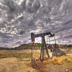 Little pumper - Wide angle view of a pumpjack on the plains of West Texas by Jacob Moore