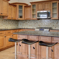 Cinnamon Maple Kitchen - Full line of Raised Panel kitchen Cabinets and Vanities with a large selection of Accessories finished in a Cinnamon Color
