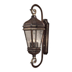 """Minka Lavery - Traditional Marietta Collection 34 1/2"""" High Outdoor Wall Light - The dual scrolls that form the arms which hold this outdoor wall light in place have a noble decorative look. A hinged door allows easy access for changing bulbs. This lantern-like design from Minka has a powder coat hand-applied multi-step finish. The Mossoro Walnut finish has silver highlights which add depth and a nuanced luxurious look. The tapered proportions are complemented by the water glass panels. Mossoro Walnut finish with Silver Highlights. Water glass. Metal candle sleeves. Takes three 60 watt candelabra bulbs (not included). 10"""" wide. 34 1/2"""" high. Extends 14 1/2"""" from the wall.  Mossoro Walnut finish with Silver Highlights.   Water glass panels.  Takes three 60 watt candelabra bulbs (not included).   Metal candle sleeves.  34 1/2"""" high.  10"""" wide.   Extends 14 1/2"""" from wall."""