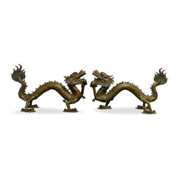 China Furniture and Arts - Bronze Flying Dragons - From head to tail, this pair of magnificent bronze dragons measures over six feet long. Each holding a ball containing power and magic, the dragons represent peace and prosperity. Perfect to place in front of the fire place or in the garden. Hand crafted from solid bronze. Sold as a pair.