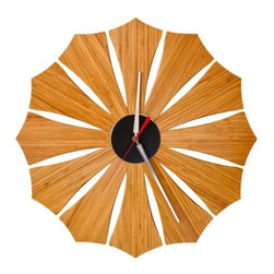 Schmitt Design - Bloom Wall Clock by Schmitt Design - The Schmitt Design Bloom Wall Clock has natural tones and radial symmetry inspired by that found in nature. It features 12 stylized petals of warm Amber bamboo accented by a central beveled aluminum disc and stainless steel hands. The clock is given an even greater sense of depth with chamfered edges and off-the-wall mounting. In 2012, Schmitt Design became the new name for Adrift Mobiles, founded by Brian Schmitt. The name change came about as, while still specializing in contemporary mobiles for adults, the company has expanded to include a line of award-winning modern lighting, clocks and furniture. All Schmitt Design pieces are created and manufactured in Sacramento, California.