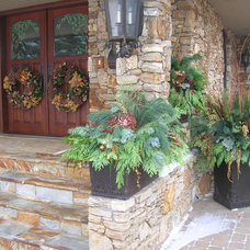 Traditional Outdoor Pots And Planters by Calgary Greenworks