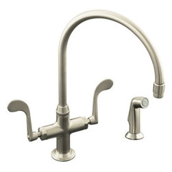 Kohler - Kohler K-8763-BN Brushed Nickel Essex Double Handle Single Hole - Essex  kitchen sink faucet with wristblade handles and sidespray Perfect for your bar or game room lavatory, the Essex entertainment sink faucet features ADA-compliant wristblade handles and single-hole installation for a clean, functional look. The swing spout and sidespray provide the accessibility and convenience you need for entertaining large groups of friends and family. Solid brass construction and a one-piece ceramic valve that resists debris and hard water buildup ensure years of reliable performance.  Wristblade handles meet ADA requirements  Low-flow aerator option available (please see latest price book)
