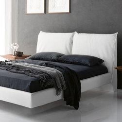 Cattelan Italia - Lukas Bed | Cattelan Italia - Made in Italy by Cattelan Italia. Meticulously crafted with comfort and quality in mind, Lukas beds promise superior relaxation whether at bed time, reading time, or TV time.  While your choice of mattress (not included) may be second to none, you'll just love the fluffy, cushy support offered by the lavishly cushioned headboard. Staying true to Italian quality of craftsmanship, this bed's sleek and contemporary frame is upholstered with luxurious leather, which comes in a range of colors and textures. Completing the chic look are the chrome steel feet cleverly hidden to give the bed the appearance of floating. Mattress base not included. Different sizes available. Meet European manufacturing standards.