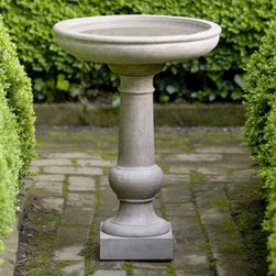 Campania International Williamsburg Tea Table Cast Stone Bird Bath - About Campania InternationalEstablished in 1984, Campania International's reputation has been built on quality original products and service. Originally selling terra cotta planters, Campania soon began to research and develop the design and manufacture of cast stone garden planters and ornaments. Campania is also an importer and wholesaler of garden products, including polyethylene, terra cotta, glazed pottery, cast iron, and fiberglass planters as well as classic garden structures, fountains, and cast resin statuary.Campania Cast Stone: The ProcessThe creation of Campania's cast stone pieces begins and ends by hand. From the creation of an original design, making of a mold, pouring the cast stone, application of the patina to the final packing of an order, the process is both technical and artistic. As many as 30 pairs of hands are involved in the creation of each Campania piece in a labor intensive 15 step process.The process begins either with the creation of an original copyrighted design by Campania's artisans or an antique original. Antique originals will often require some restoration work, which is also done in-house by expert craftsmen. Campania's mold making department will then begin a multi-step process to create a production mold which will properly replicate the detail and texture of the original piece. Depending on its size and complexity, a mold can take as long as three months to complete. Campania creates in excess of 700 molds per year.After a mold is completed, it is moved to the production area where a team individually hand pours the liquid cast stone mixture into the mold and employs special techniques to remove air bubbles. Campania carefully monitors the PSI of every piece. PSI (pounds per square inch) measures the strength of every piece to ensure durability. The PSI of Campania pieces is currently engineered at approximately 7500 for optimum strength. Each piece is air-dried and then de-molded by hand. After an internal quality check, pieces are sent to a finishing department where seams are ground and any air holes caused by the pouring process are filled and smoothed. Pieces are then placed on a pallet for stocking in the warehouse.All Campania pieces are produced and stocked in natural cast stone. When a customer's order is placed, pieces are pulled and unless a piece is requested in natural cast stone, it is finished in a unique patinas. All patinas are applied by hand in a multi-step process; some patinas require three separate color applications. A finisher's skill in applying the patina and wiping away any excess to highlight detail requires not only technical skill, but also true artistic sensibility. Every Campania piece becomes a unique and original work of garden art as a result.After the patina is dry, the piece is then quality inspected. All pieces of a customer's order are batched and checked for completeness. A two-person packing team will then pack the order by hand into gaylord boxes on pallets. The packing material used is excelsior, a natural wood product that has no chemical additives and may be recycled as display material, repacking customer orders, mulch,or even bedding for animals. This exhaustive process ensures that Campania will remain a popular and beloved choice when it comes to garden decor.Please note this product does not ship to Pennsylvania.