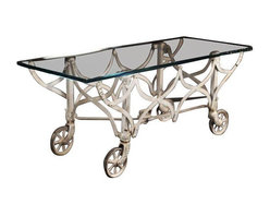 Pre-owned Vintage Fold Up Coffee Table - With curves that provide an understated elegance and industrial edge, this piece of art has been given new life. Beneath the glass top is a graceful fold-up cart from a midwestern factory ca. 1950. On top floats a pristine piece of glass with precision-cut and polished edges.