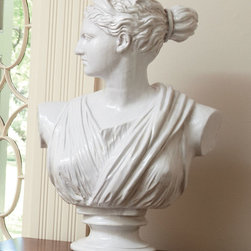 Diana Bust - A massive focal piece best exhibited by a dedicated pedestal or architectural niche, the Diana Bust brings expressive form from the height of Greco-Roman artistry to your home.  Swathed in Classical drapery and crafted in milk-white stone for the look of an artifact freshly recovered from the ruins of grandeur, this stunning piece of sculpture is a striking centerpiece to any view.