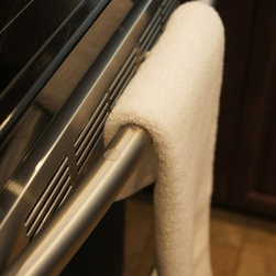 Non Slip Towel Bar Grip - This towel should be slipping off, but stays on the kitchen stove handle thanks to Non Slip Towel Grip