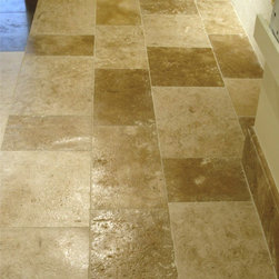 French Refined limestone - Truly a classic French limestone floor, this stone has been used locally for centuries in France. Only with the introduction of modern cutting equipment have the qualities of this stone become more widely appreciated. A stone of light golden-brown tones on a cream background with occasional veining. This is the standard understated limestone to which others are compared and equally suited for traditional and modern design schemes.