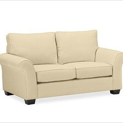 """PB Comfort Roll Upholstered Loveseat Knife-Edge, Polyester Cushions, Textured Ba - Built by our exclusive master upholsterers in the heart of North Carolina, our PB Comfort Upholstered Love Seat is designed for unparalleled comfort with deep seats and three layers of padding. 68.5"""" w x 40"""" d x 37"""" h {{link path='pages/popups/PB-FG-Comfort-Roll-Arm-4.html' class='popup' width='720' height='800'}}View the dimension diagram for more information{{/link}}. {{link path='pages/popups/PB-FG-Comfort-Roll-Arm-6.html' class='popup' width='720' height='800'}}The fit & measuring guide should be read prior to placing your order{{/link}}. Choose polyester wrapped cushions for a tailored and neat look, or down-blend for a casual and relaxed look. Choice of knife-edged or box-style back cushions. Proudly made in America, {{link path='/stylehouse/videos/videos/pbq_v36_rel.html?cm_sp=Video_PIP-_-PBQUALITY-_-SUTTER_STREET' class='popup' width='950' height='300'}}view video{{/link}}. For shipping and return information, click on the shipping tab. When making your selection, see the Quick Ship and Special Order fabrics below. {{link path='pages/popups/PB-FG-Comfort-Roll-Arm-7.html' class='popup' width='720' height='800'}} Additional fabrics not shown below can be seen here{{/link}}. Please call 1.888.779.5176 to place your order for these additional fabrics."""