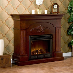 Southern Enterprises - Southern Enterprises Sicilian Harvest Mahogany Electric Fireplace Brown - FA9277 - Shop for Fire Places Wood Stoves and Hardware from Hayneedle.com! Strong and proud the Southern Enterprises Sicilian Harvest Mahogany Electric Fireplace has a hint of elegant European design. Heavy fluted columns support the thick mantel with compound crown molding in between. A striking headpiece is carved into the face for a one-of-a-kind presentation. It exemplifies Old-World quality with modern features. This easy-to-use fireplace requires no electrician. Just plug it in turn it on and enjoy the cozy atmosphere in your home or office. It's energy-efficient too. It heats 1500 cubic feet in only 24 minutes and features LED flames using about the same energy as a coffee maker and produces zero emissions or pollutants. Plus you can enjoy the flames with or without heat. It s safe as well: the glass stays cool to the touch. So kick off your shoes pick up the included remote control and start relaxing in the warm glow. About SEI (Southern Enterprises Inc.)This item is manufactured by Southern Enterprises or SEI. Southern Enterprises is a wholesale furniture accessory import company based in Dallas Texas. Founded in 1976 SEI offers innovative designs exceptional customer service and fast shipping from its main Dallas location. It provides quality products ranging from dinettes to home office and more. SEI is constantly evolving processes to ensure that you receive top-quality furniture with easy-to-follow instruction sheets. SEI stands behind its products and service with utmost confidence.