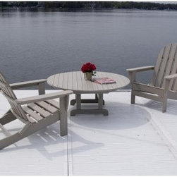 POLYWOOD® Curved Back Adirondack Conversation Patio Set - The PolyWood Curved Back Adirondack Conversation Patio Set allows you to enjoy time outdoors with friends or family in hassle-free style since recycled plastic is virtually maintenance-free. This is an excellent all-weather set perfect for poolside or your lake home. The Curved Back Adirondack Conversation Set is durable attractive and worry-free! Use the umbrella hole in the low-dining-style table to add shade and a colorful accent to this charming conversation set. Available in several colors so you can tailor the set to your desires. Some assembly required.About PolyWoodThe advantages of PolyWood Recycled Plastic are hard to ignore. PolyWood absorbs no moisture and will NOT rot warp crack splinter or support bacterial growth. PolyWood is also compounded with permanent UV-stabilized colors which eliminates the need for painting staining waterproofing stripping and resurfacing. This material is impervious to many substances including salt water gasoline paint stains and mineral spirits. In addition every PolyWood product comes with stainless steel hardware.PolyWood is extremely easy to clean and maintain. Simple soap and water is all you need to get rid of dirt and make your furniture look new again. For extreme cleaning needs you can use a 1/3 bleach-and-water solution. Most PolyWood furnishings are available in a variety of classic colors which allow you to choose your favorite or coordinate with the furniture you already have. This is sure to be a piece that you will be proud to own for a lifetime.