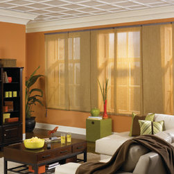 Fabric Sliding Panels - American Blinds presents Bali Fabric Sliding Panels, perfect for covering patio doors, picture windows or covering closets, and great as a room divider. Also known as Panel Track, this product is available in over 100 fabrics in a beautiful color palette, with patterns or textures, including solar screen, light filtering and room darkening opacities. Panels come in a variety of sizes, and glide gracefully across a durable, aluminum track.