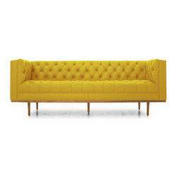 Joybird Furniture - Welles Leather Sofa - Brighton Lemon Grass Yellow - The Welles Sofa features just the right amount of sophistication along with best elements of a comfy couch!Many of our durable leathers are strong enough to stand up to even the toughest kid- and pet-related issues.Fully-lined in a timeless button-tufted design, the Welles Sofa hearkens back to the debonair aesthetic of the 1950s and 1960s.Frame: Kiln dried hardwood. Once assembled, frames are wrapped in 2lb foam exceeding industry standards. Made with responsibly-sourced wood. Legs: Solid beechSuspension: Seat - zig zag springs. Back - spring backJoints: Glued, stapled and screwed to ensure frame stability and longevity.Assembly: NoneStyle: Tight back; tight seatCushions: Contain no flame retardants or harmful chemicals. Glue and Stains: Water-based, low-VOC