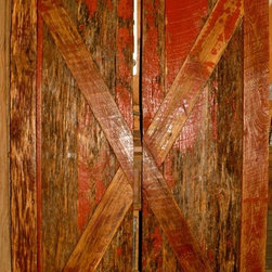 "Barn Doors - Made from reclaimed red barn wood, these particular doors are crafted a bit differently than our other sliding barn doors, but are just as sturdy and functional i.e. small gaps between the wood, and the stiles, rails and cross pieces are screwed and pegged instead of biscuit joined. The doors are original (rough) face but have been lightly sanded, sealed and finished with a ""smooth to the touch"" oil-based finish. These doors are perfect for your primitive or rustic decorating needs, and also easy on the budget!"