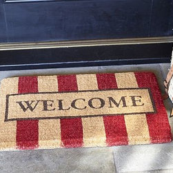 """Welcome Stripe Coir Door Mat 18 X 30 """", Red - Our take on the traditional welcome mat features eco-friendly materials, bold stripes and handsome hues. 30"""" wide x 18"""" deep Handwoven of earth-friendly coir, a durable fiber derived from coconut shells. Imported."""