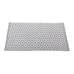 Coyuchi Organic Cotton Diamond Pebble Pewter Rugs - Step into sustainable luxury with our Diamond Pebble Pewter Rugs. Lush dhurrie diamonds in pewter and white bring soft graphic texture to kitchens, baths, bedrooms and hallways and complement any decor. Our rug is densely woven from 100% pure organic cotton in a pebbled pattern that feels smooth and springy underfoot. Finished with a neat hem on all sides; use with a rug pad for extra softness. Available in two sizes.