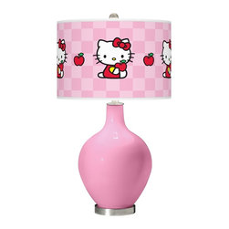 "Hello Kitty - Contemporary Pale Pink Hello Kitty Apples Ovo Table Lamp - Add a bold cheerful accent to your home décor with this Hello Kitty table lamp. Hand-crafted by experienced artisans in our California workshops the Pale Pink high-gloss base is topped with a matching Hello Kitty Apples pattern shade officially licensed from Sanrio. This contemporary design brings the iconic Kitty to life on a custom-printed giclee shade made of high-quality translucent fabric that allows light to shine through the shade. U.S. Patent # 7347593. Officially licensed design from Sanrio. Pale Pink designer glass table lamp. Hello Kitty Apples pattern translucent shade. Brushed steel finish accents. Maximum 150 watt bulb (not included). 28 1/2"" high. Shade is 15 1/2"" wide and 11"" high. Base is 6"" wide. May only ship to the United States its territories possessions and the Commonwealth of Puerto Rico. ©1976 2013 Sanrio Co. Ltd. Used Under License.  Officially licensed design from Sanrio.  Pale Pink designer glass table lamp.  Hello Kitty Apples pattern translucent shade.  Brushed steel finish accents.  Maximum 150 watt bulb (not included).  28 1/2"" high.  Shade is 15 1/2"" wide 11"" high.  Base is 6"" wide.  May only ship to the United States its territories possessions and the Commonwealth of Puerto Rico.  ©1976 2013 Sanrio Co. Ltd. Used Under License."
